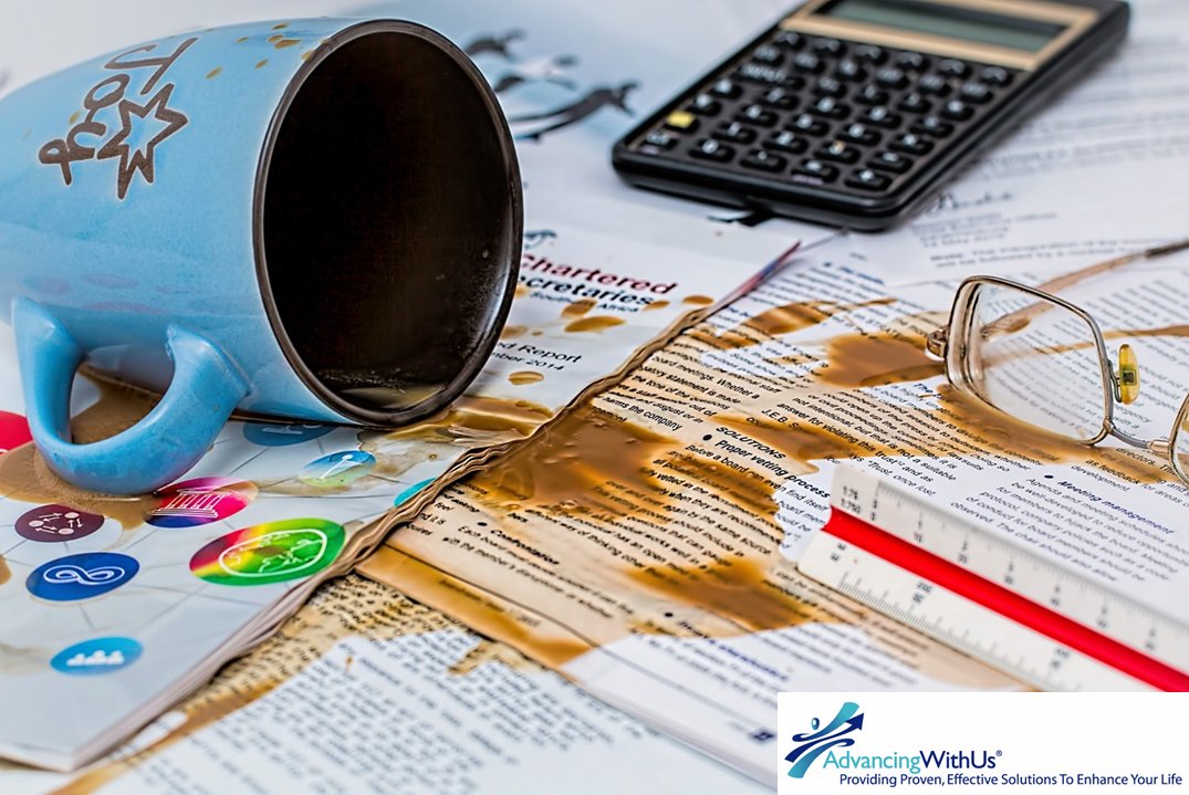 Mistake spillage on business papers from AdvancingWithUs.