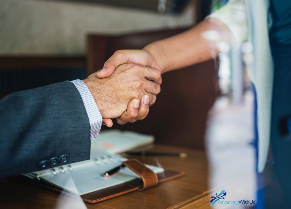 Shaking hands to close a deal with advancingwithus