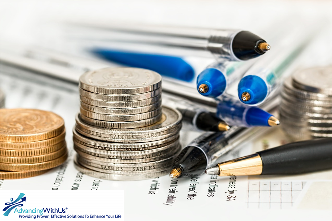 Coins and pens used to save money with AdvancinWithUs