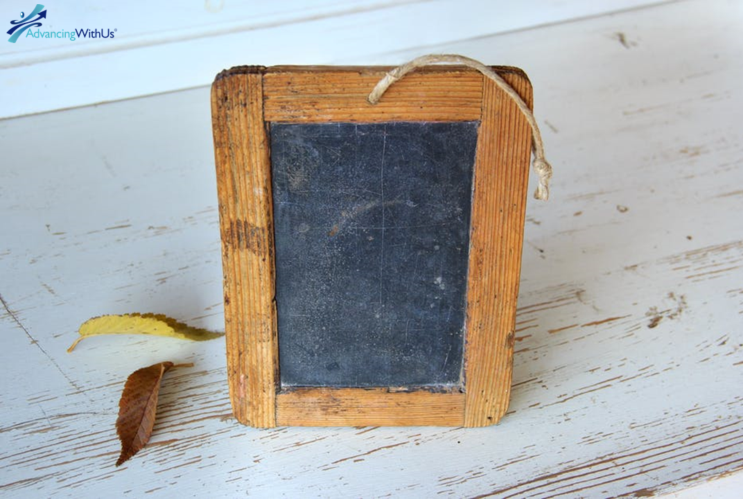 Wood chalk board with AdvancingWithUs